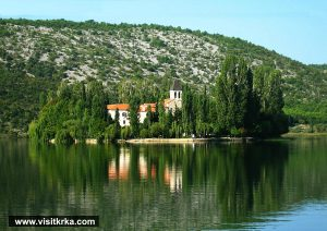 Approaching Visovac island and Monastery – see lovely water reflections
